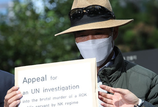 In this file photo, Lee Rae-jin, the elder brother of a South Korean official killed by North Korean soldiers while drifting in its waters, holds a petition at the UN office on North Korea's human rights in Seoul on Oct. 6, 2020, to appeal to the United Nations that a
