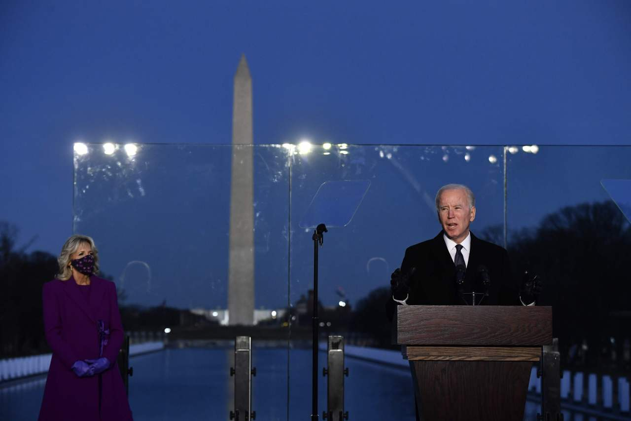 US President-elect Joe Biden delivers a speech at a memorial for those who died of COVID-19, an event held at Washington's Lincoln Memorial on Tuesday night, local time, a day ahead of inauguration. (Yonhap)