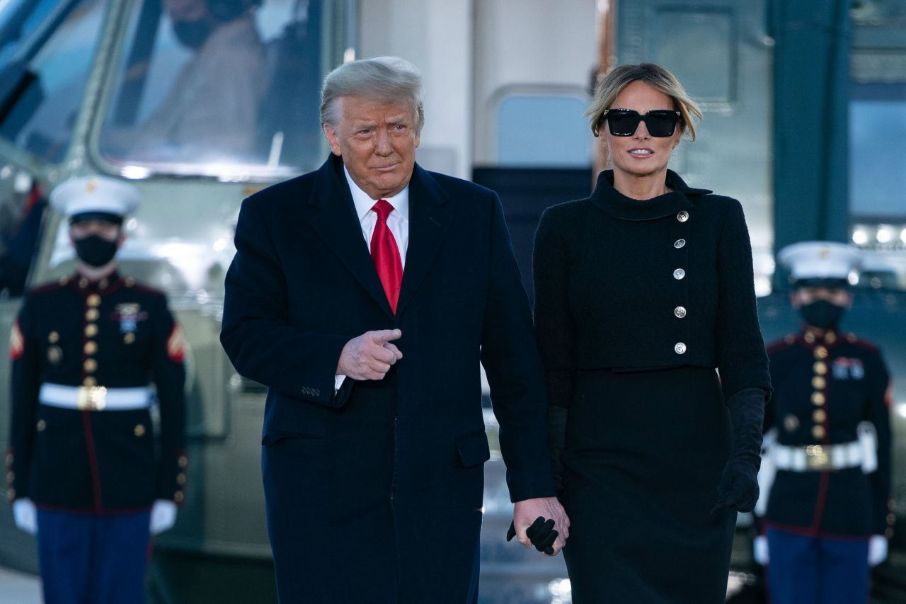 Outgoing US President Donald Trump and First Lady Melania Trump step out of Marine One at Joint Base Andrews in Maryland on Wednesday. (AFP-Yonhap)