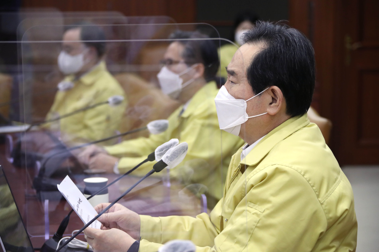 Prime Minister Chung Sye-kyun presides over a meeting of the Central Disaster and Safety Countermeasures Headquarters about measures against the spread of the new coronavirus at the government complex in Seoul on Thursday. (Yonhap)