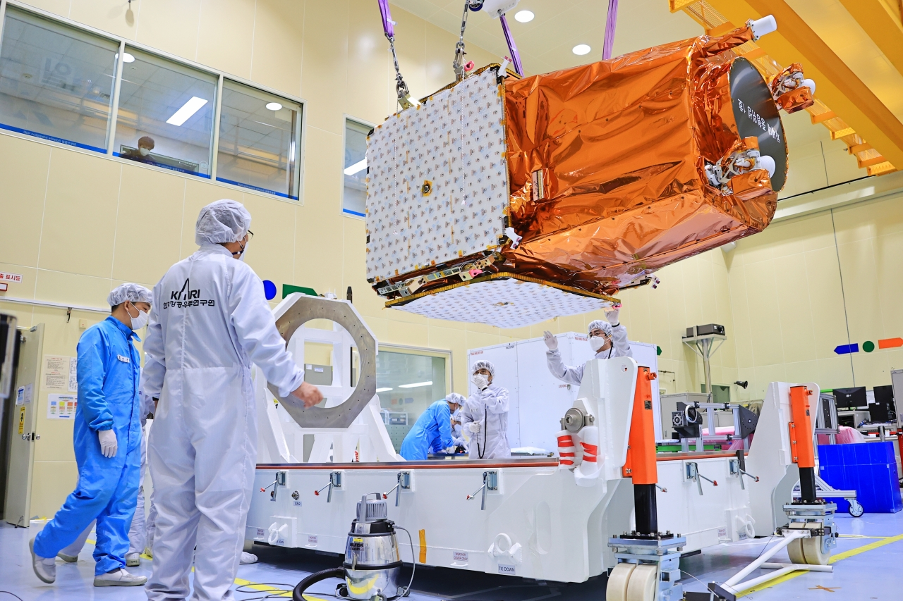 South Korean researchers test the country's new mid-sized satellite that will be launched on March 20, from Kazakhstan. (Yonhap)