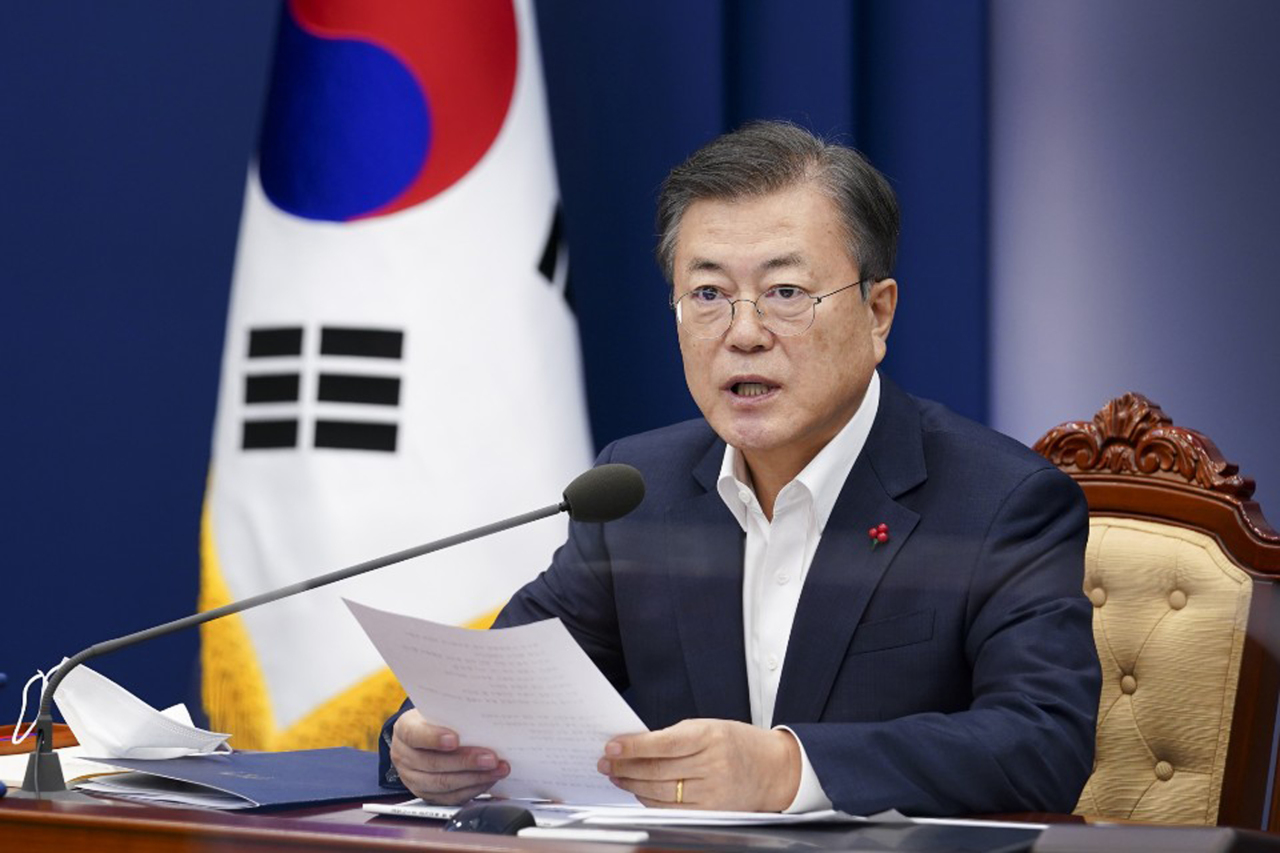 President Moon Jae-in speaks at a meeting tied to briefings from health authorities held at Cheong Wa Dae on Monday. (Yonhap)
