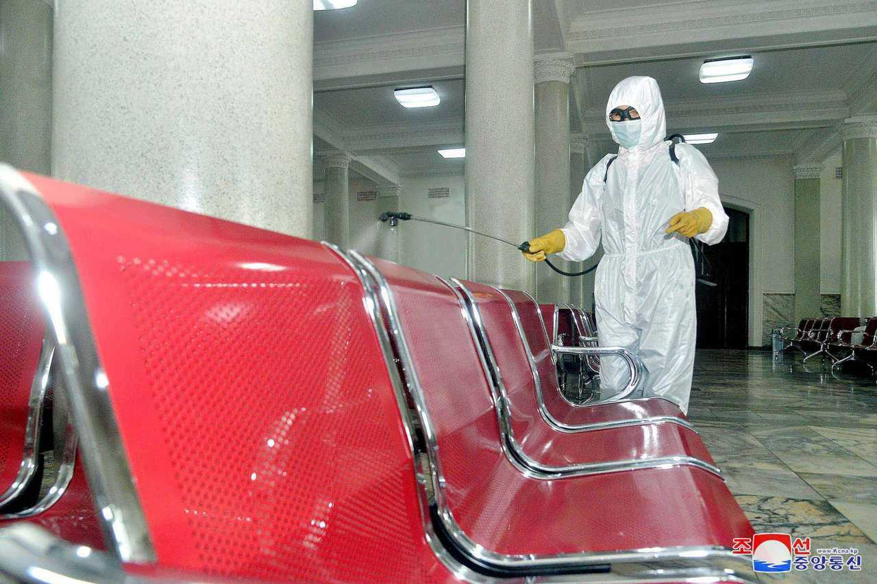 A health worker sanitizing Pyongyang Station in the capital to prevent the outbreak of the coronavirus. (KCNA-Yonhap)