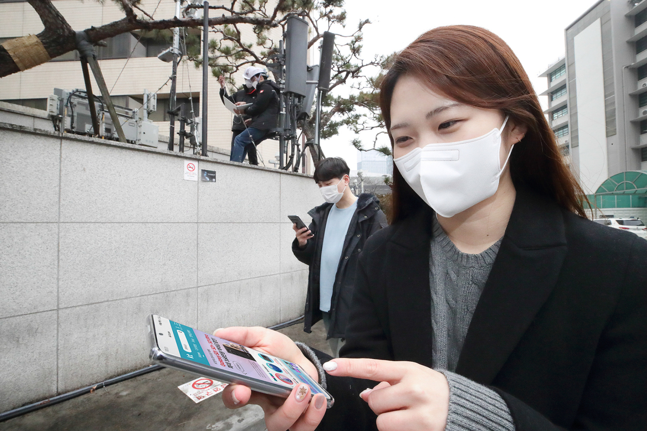 This photo, provided by KT Corp. on Wednesday, shows the company's workers testing standalone 5G near its offices in central Seoul. (KT Corp.)