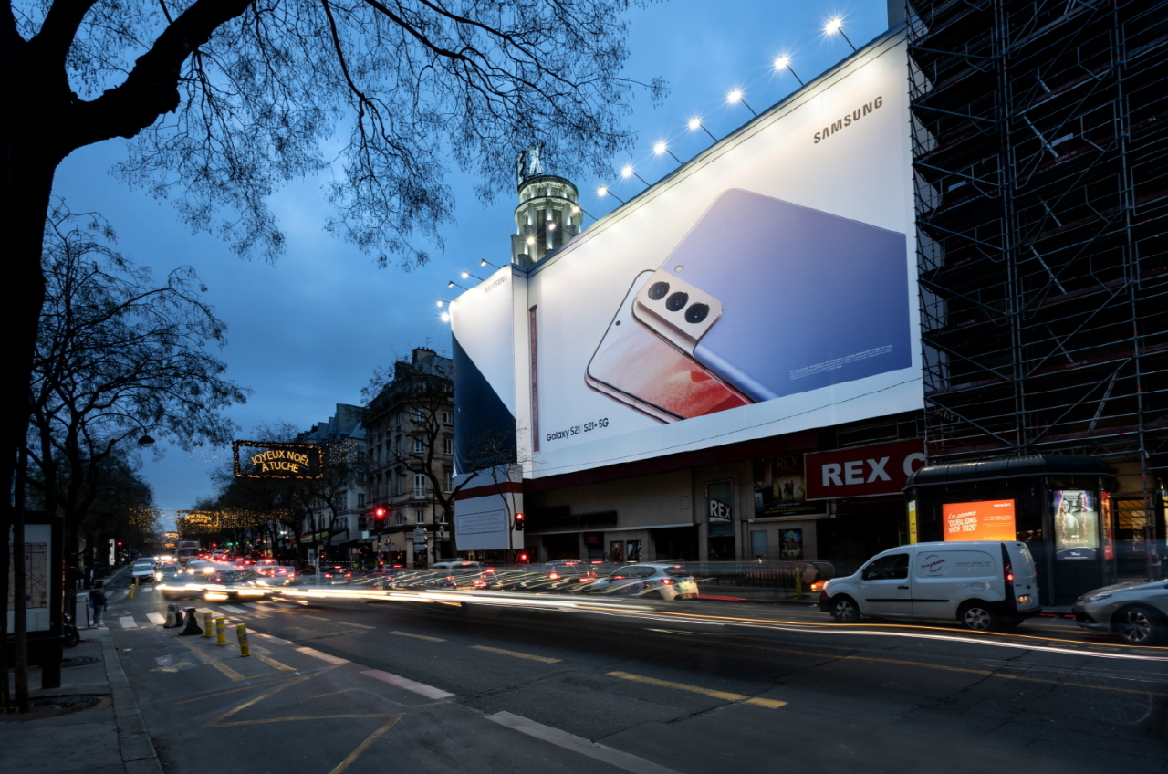 This photo provided by Samsung Electronics Co. on Friday, shows an outdoor advertisement for Samsung's Galaxy S1 smartphone at Le Grand Rex theater in Paris. (Samsung Electronics Co.)