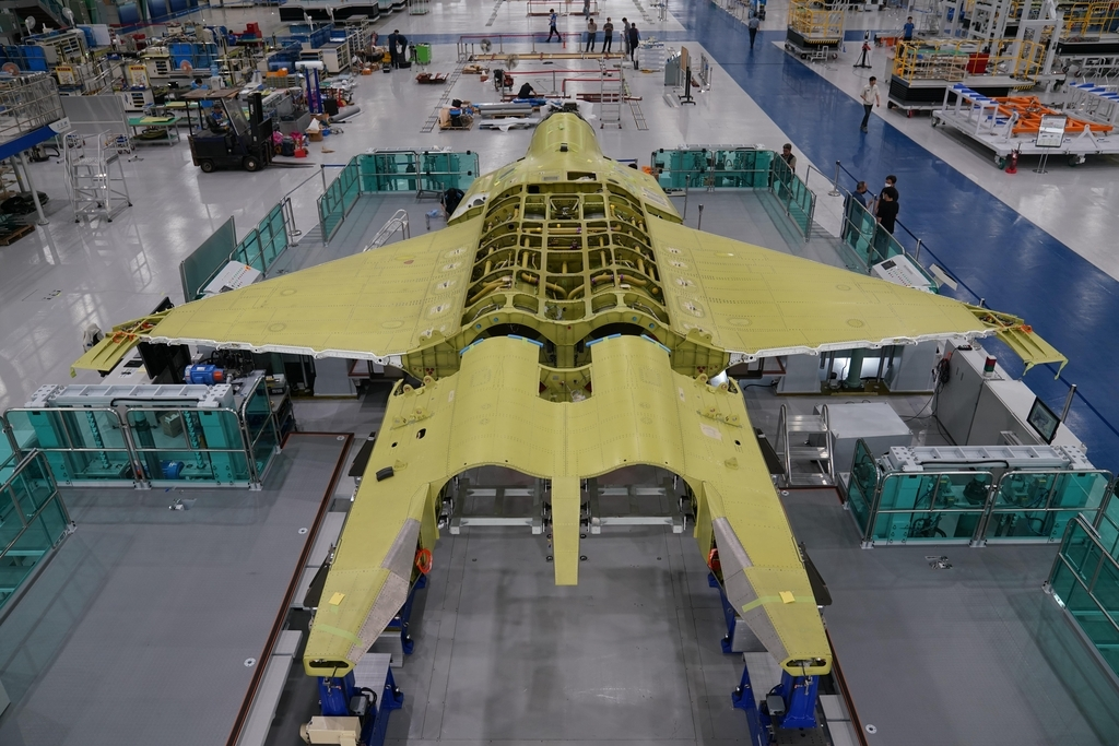 This photo provided by the Defense Acquisition Program Administration on Sept. 3, 2020, shows a prototype of South Korea's envisioned fighter jet being assembled at the Korea Aerospace Industries Co. facility in Sacheon, South Gyeongsang Province, southeastern South Korea. Under the KF-X project worth 8.8 trillion won ($7.3 billion), South Korea has been working since late 2015 to develop a homegrown cutting-edge fighter aircraft to replace the Air Force's aging fleet of F-4 and F-5 jets. (Defense Acquisition Program Administration)
