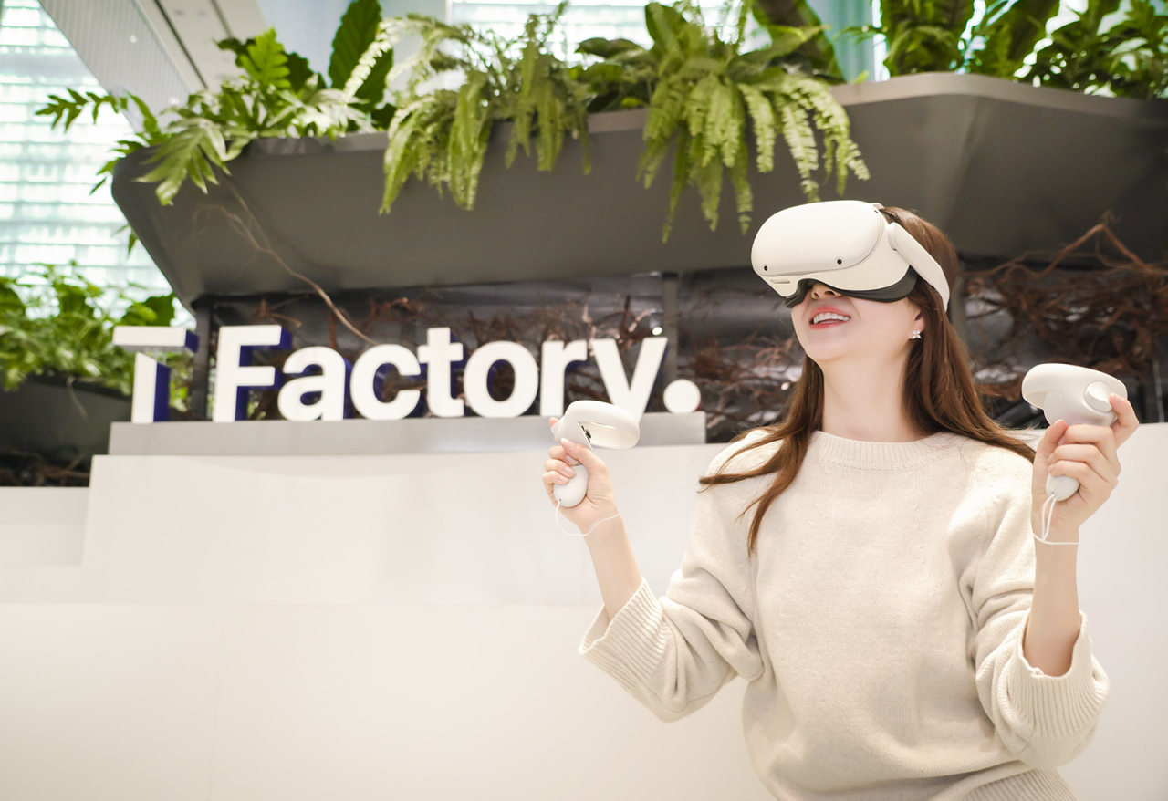 This photo, provided by SK Telecom Co. on Monday, shows a model using Facebook Inc.'s Oculus Quest 2 device at the mobile carrier's store in Seoul. (SK Telecom Co.)