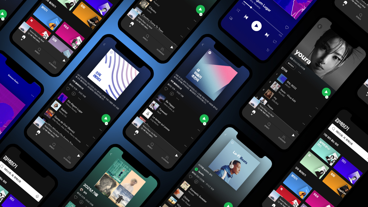 Smartphone screens display the Spotify app, after it launched its service in Korea on Monday. (Spotify)