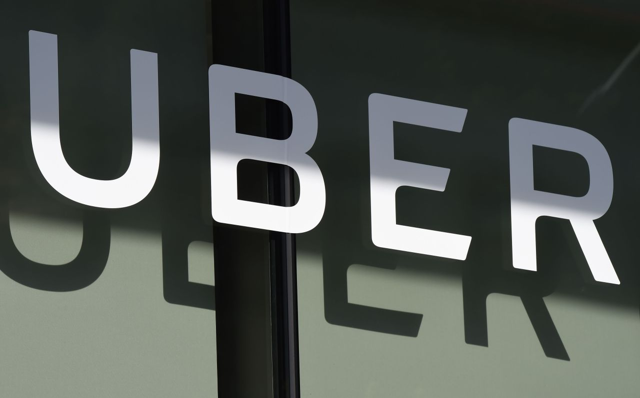 In this file photo taken on May 8, 2019 an Uber logo is seen outside the company's headquarters in San Francisco, California. (AFP-Yonhap)