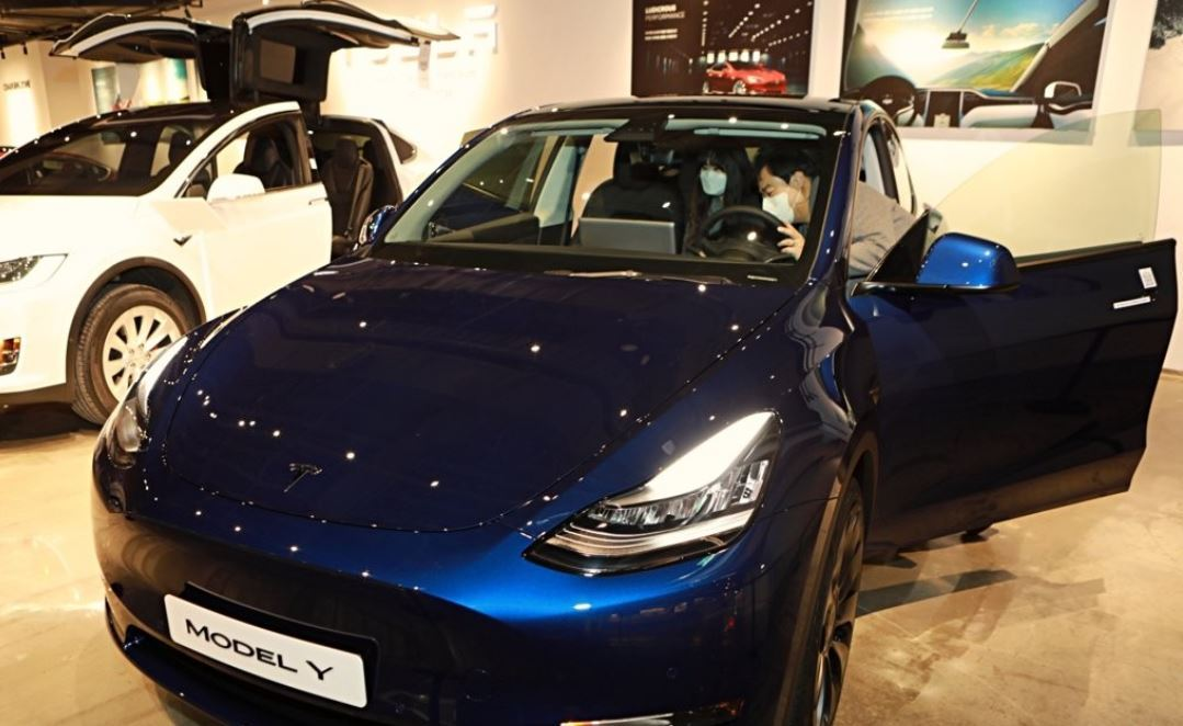 This image provided by Lotte Shopping on Jan. 13, 2021, shows the Model Y SUV from Tesla Inc. displayed at a department store in Seoul. (Yonhap)