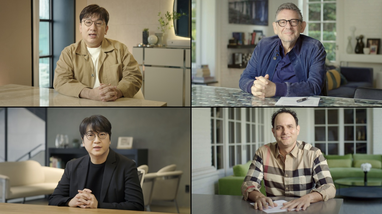 (From top left, clockwise) Big Hit Entertainment founder and CEO Bang Si-hyuk, UMG CEO and Chairman Lucian Grainge, Geffen A&M Records CEO John Janick, and Big Hit Entertainment global CEO Lenzo Yoon speak in the announcement video released on Feb. 18, 2021. (Big Hit Entertainment/Universal Music Group)