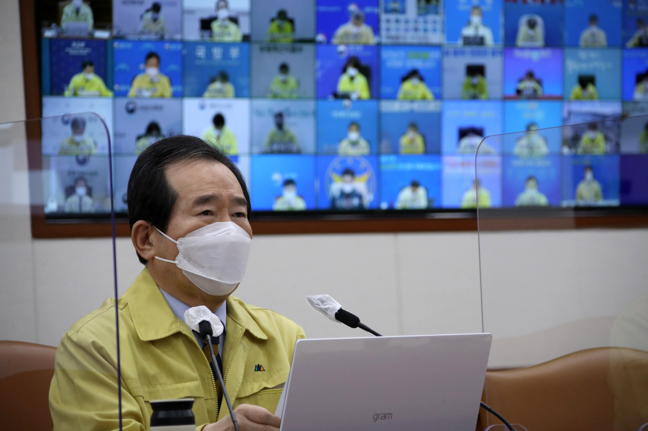 Prime Minister Chung Sye-kyun presides over a meeting of the Central Disaster and Safety Countermeasures Headquarters about measures to prevent the spread of the new coronavirus at the government complex in Seoul on Friday. (Yonhap)