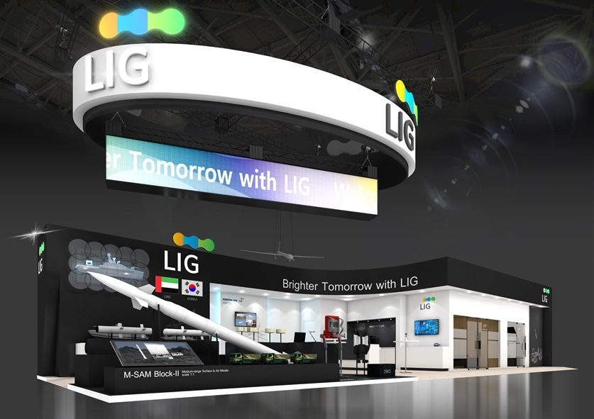 A rendering of LIG Nex1's booth in IDEX 2021, where the company will showcase its medium-range surface-to-air M-SAM II missile, anti-tank guided missile Raybolt, wearable robot Lexo, unmanned surface vehicle Sea Sword and multipurpose, compact drone systems. (LIG Nex1)