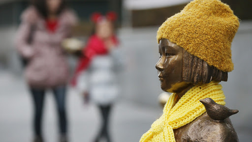 A statue of a girl symbolizing