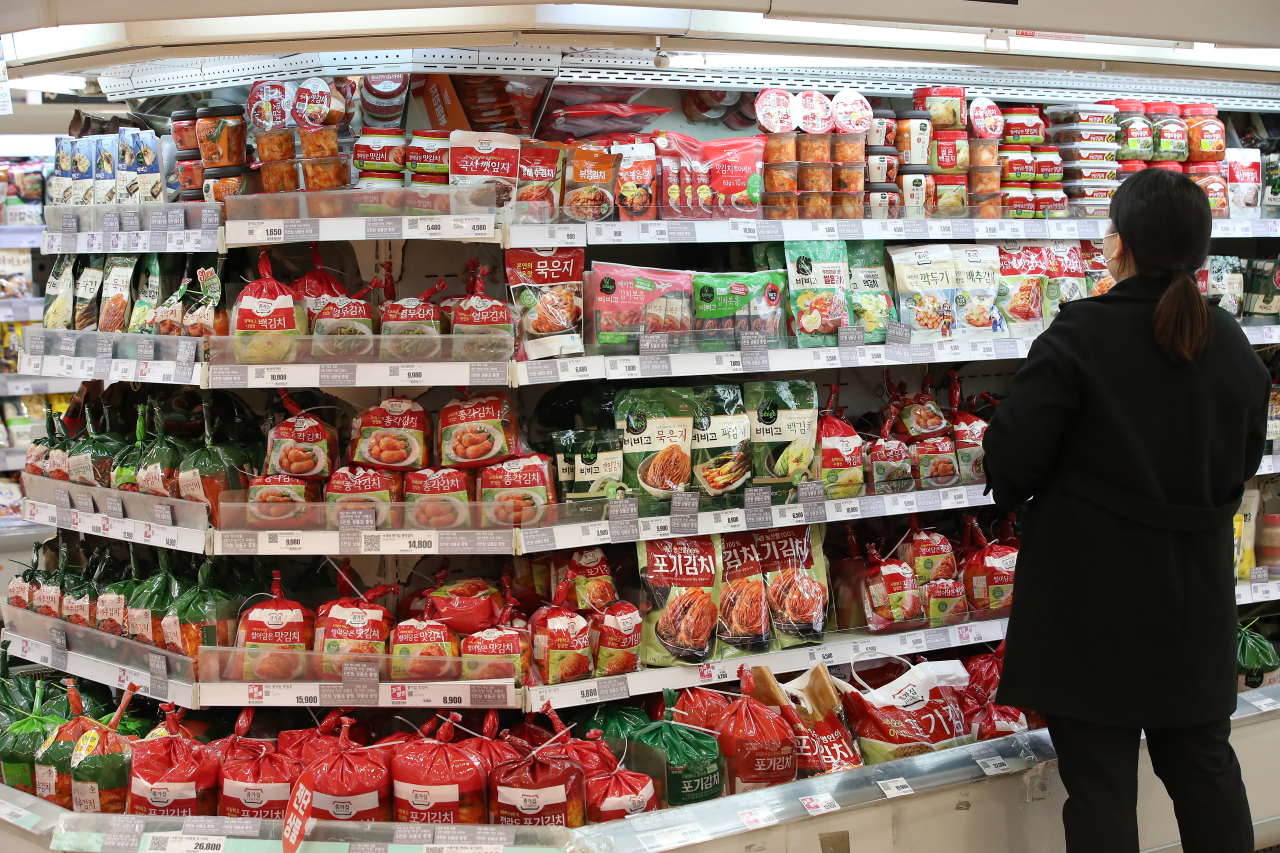 In the Feb. 15, 2021, file photo, a woman shops for groceries at a supermarket in Seoul. (Yonhap)