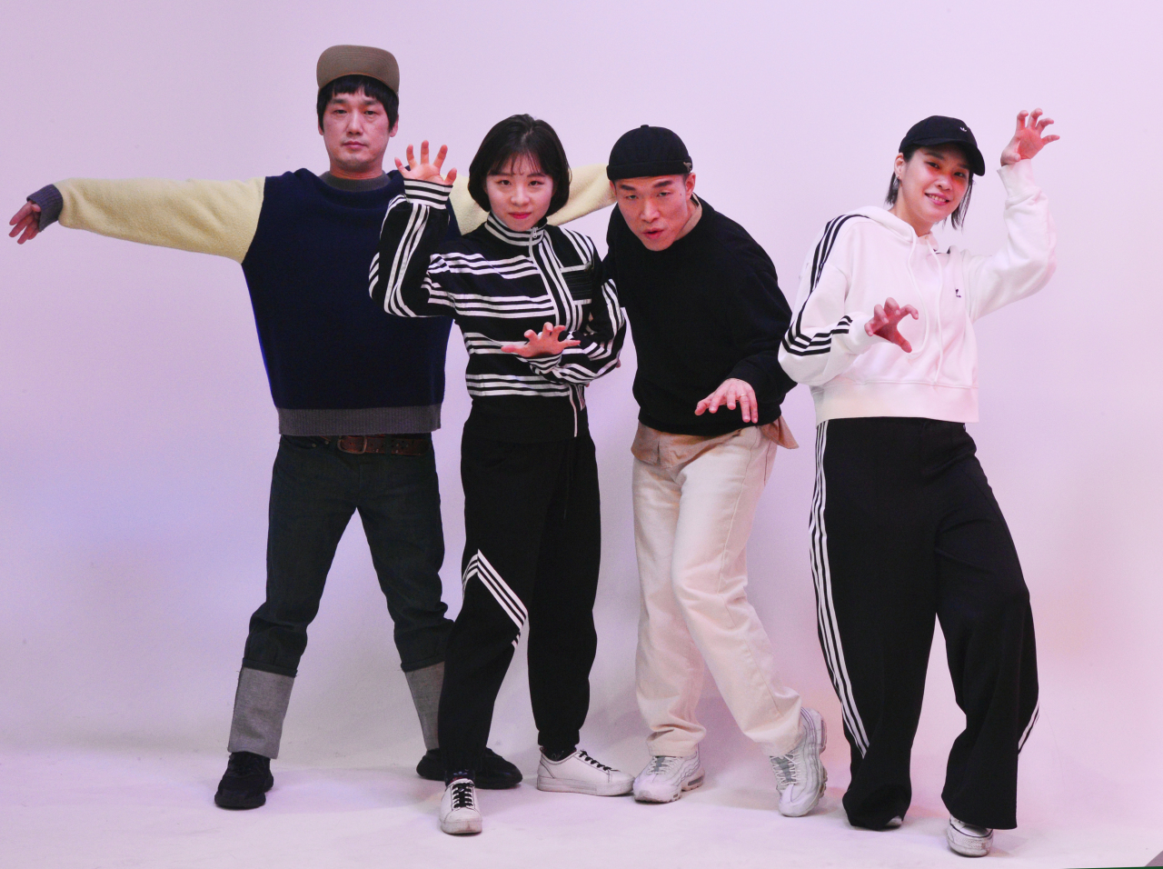 Four members of Band Leenalchi -- (from left) drummer Lee Chul-hee and vocalists Shin Yu-jin, Ahn Yi-ho, Kwon Song-hee -- pose before an interview with The Korea Herald at the office's studio in Seoul on Feb. 19. (Park Hyun-koo/ The Korea Herald)