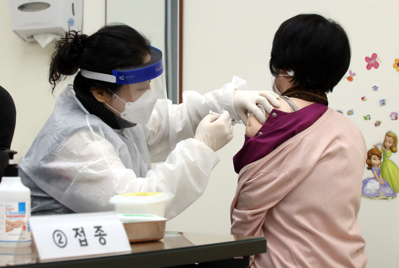 A citizen receives a shot of COVID-19 vaccine at a public health center in Incheon, west of Seoul, on Friday. (Yonhap)