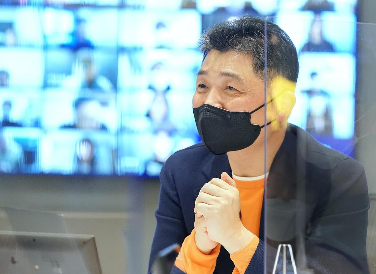 This photo provided by Kakao Corp. on Thursday, shows Kakao founder Kim Beom-su speaking at an online conference with his employees. (Kakao Corp.)