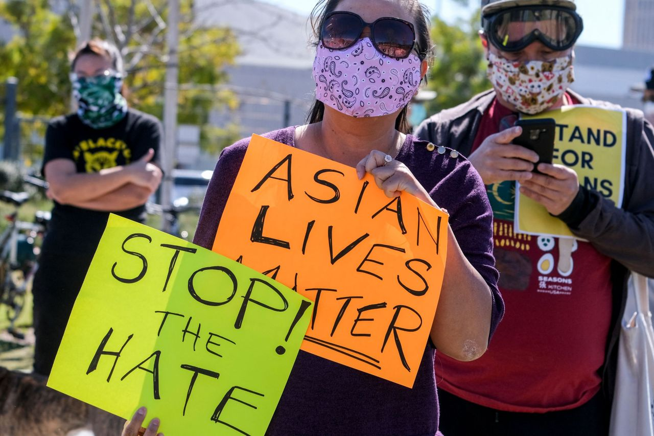 Demonstrators wearing face masks and holding signs take part in a rally to raise awareness of anti-Asian violence, near Chinatown in Los Angeles, California, on February 20. (AFP-Yonhap)