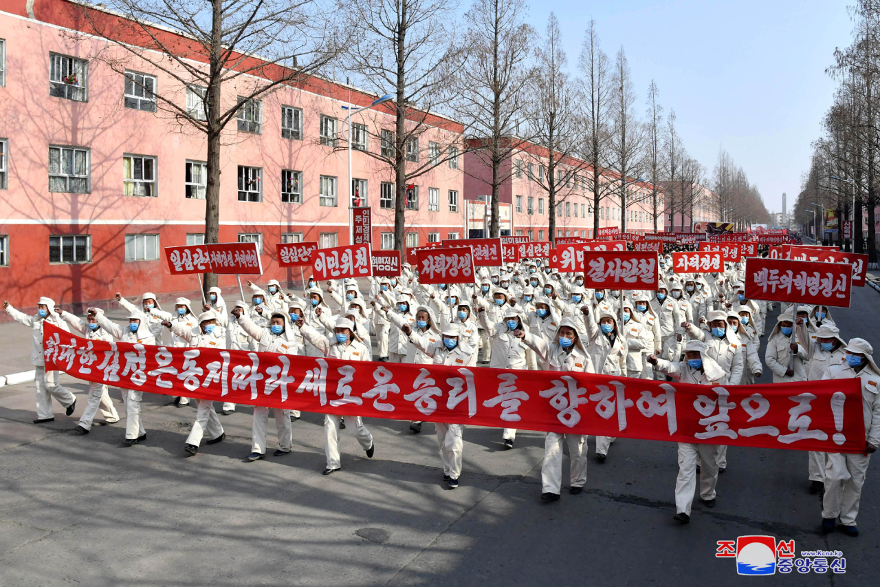 In this photo released by the Korean Central News Agency, North Korean workers hold a rally at the Hwanghae Iron and Steel Complex in Songrim, Hwanghae Province, on Feb. 20, 2021, vowing to carry out the tasks in the first year of the North's new five-year economic plan adopted earlier this year. (KCNA-Yonhap)