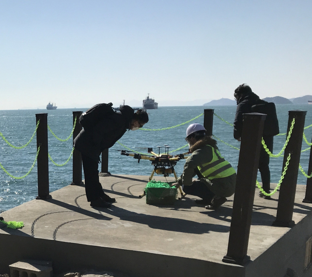 Employees launch a drone to deliver items to ships near Busan Port. (Marine Drone Tech)