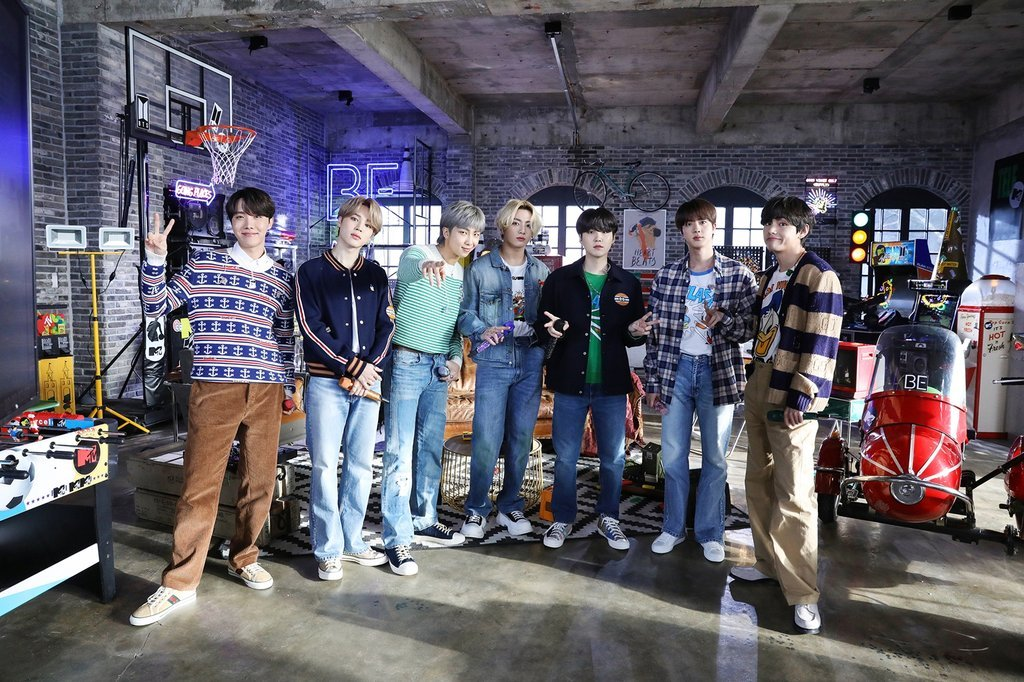 This photo, provided by Big Hit Entertainment last Wednesday, shows BTS on a set for
