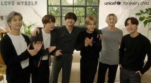 This photo, provided by the Korean Committee for UNICEF on Friday, shows BTS taking part in the