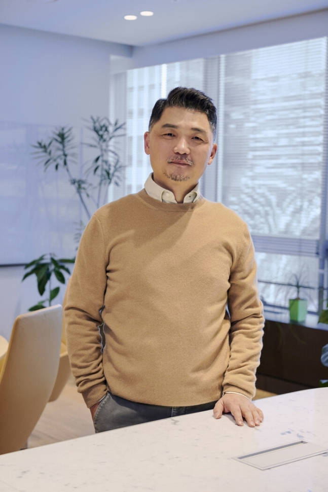This undated image, provided by South Korea's top mobile messenger operator Kakao Corp., shows the company's founder, Kim Beom-su. (Kakao Corp.)