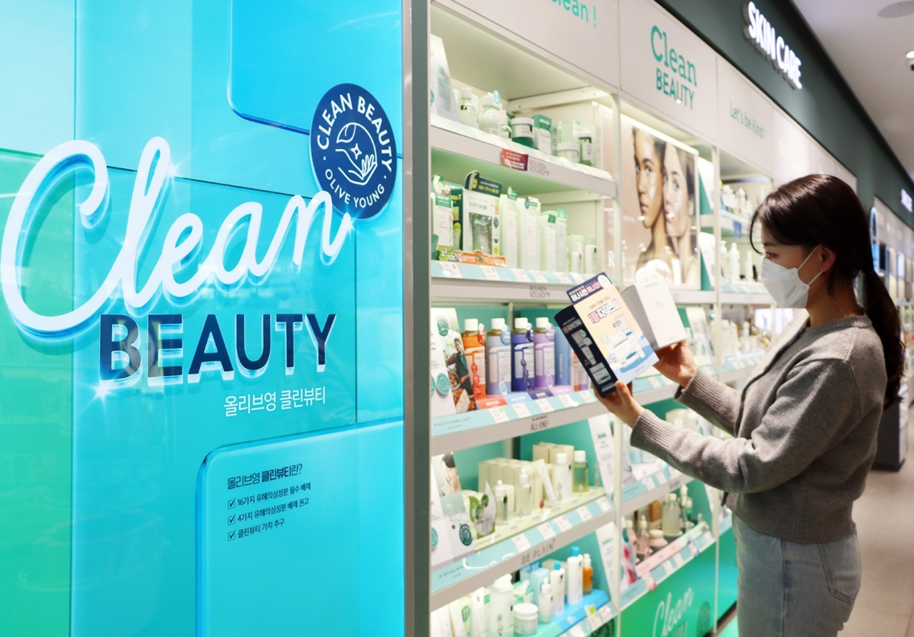 A customer checks out a 'clean beauty' product at an Olive Young store. (Olive Young)