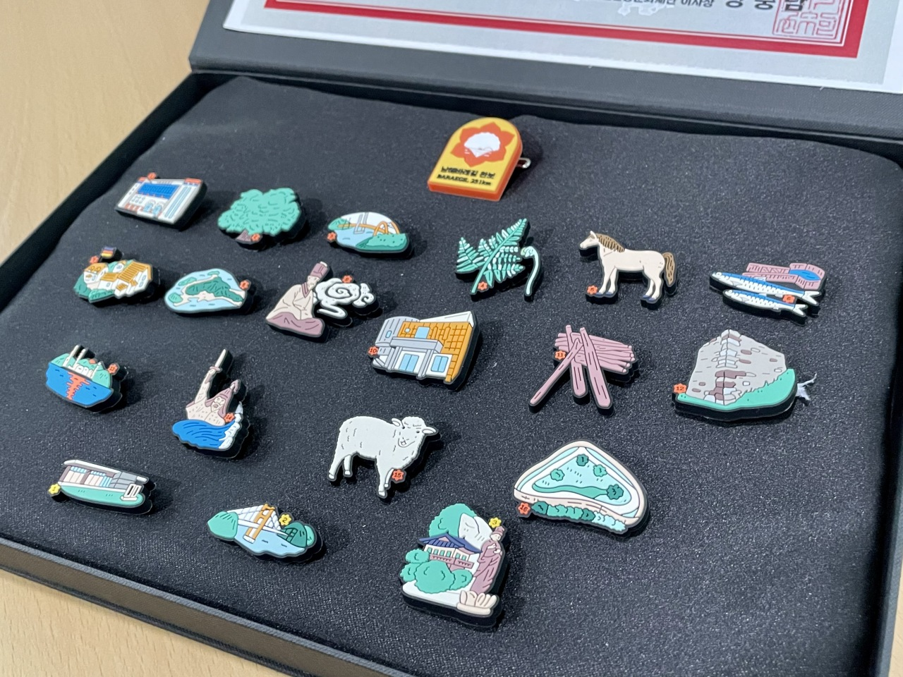 Badges given to trekkers who complete Namhae Baraegil Trail (Photo by Im Eun-byel / The Korea Herald)