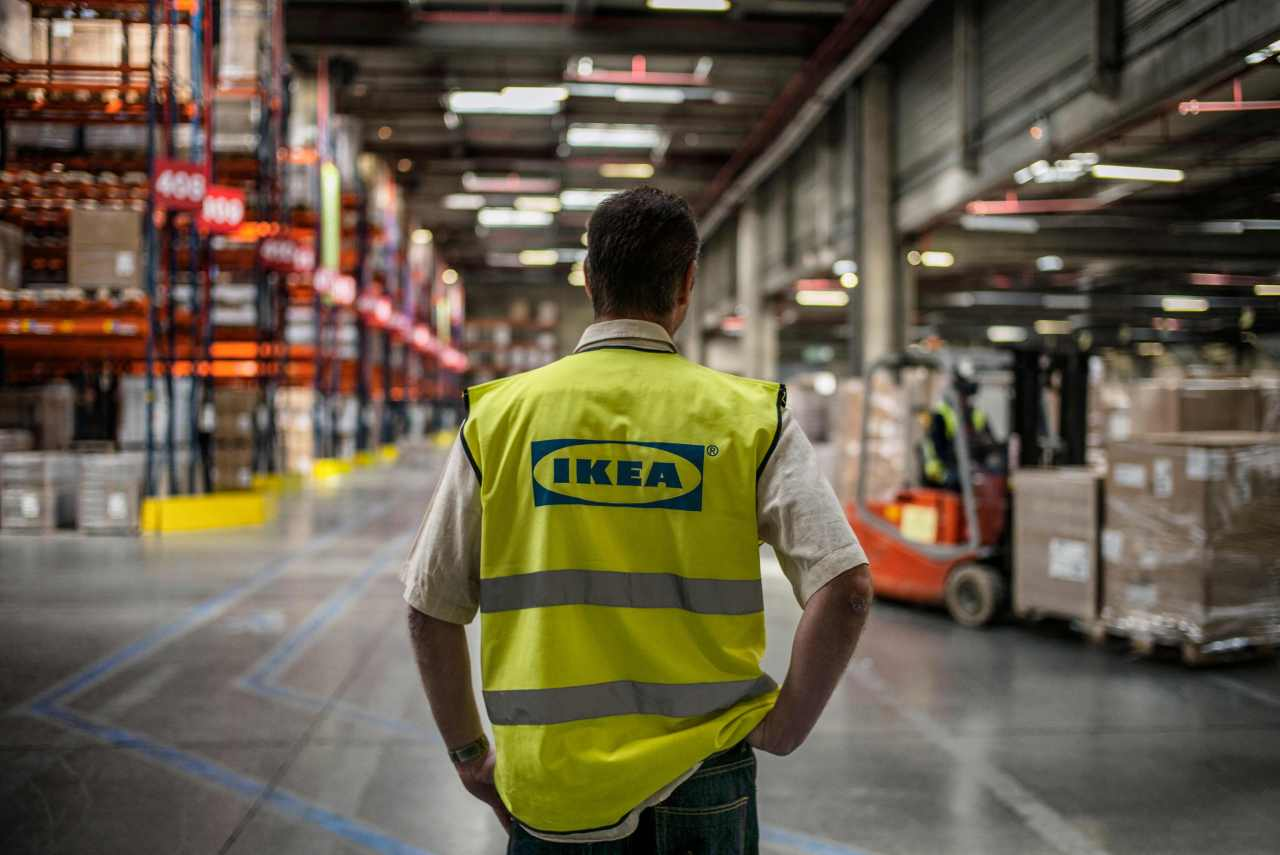 In this file photo taken on Thursday, an employee is at work at a warehouse of world`s largest furniture retailer Ikea in Saint-Quentin-Fallavier. (AFP-Yonhap)