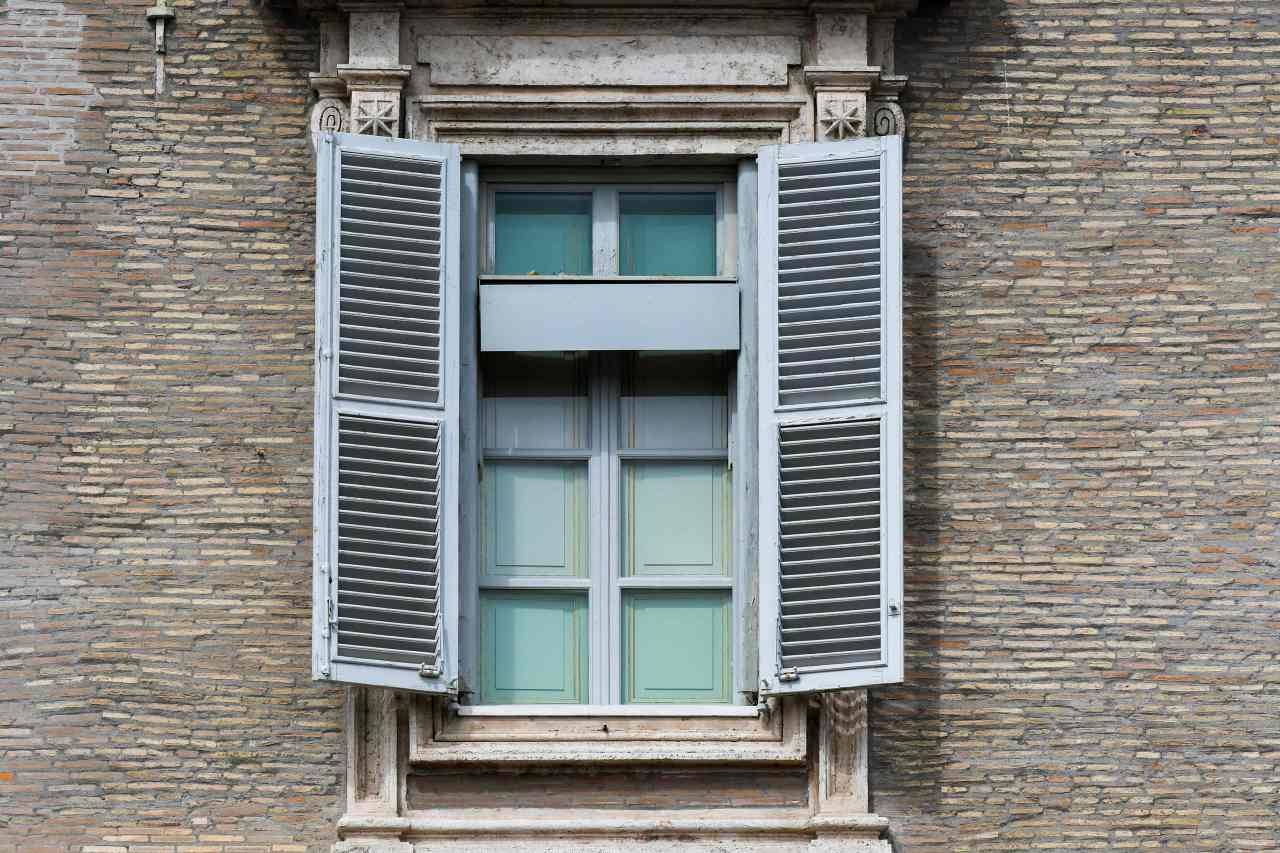 The window of the apostolic palace from which the Pope usually delivers its weekly Angelus prayer remains closed as the Pope holds a live streamed prayer instead, Sunday. (AFP-Yonhap)