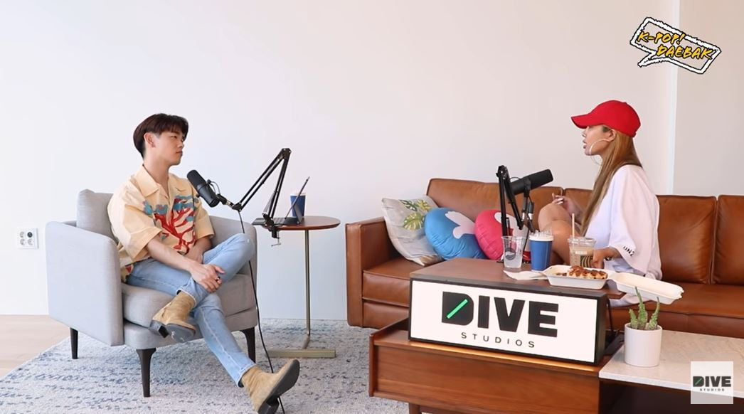 A screenshot shows K-pop Daebak host Eric Nam (left) and guest Jessi. (YouTube)