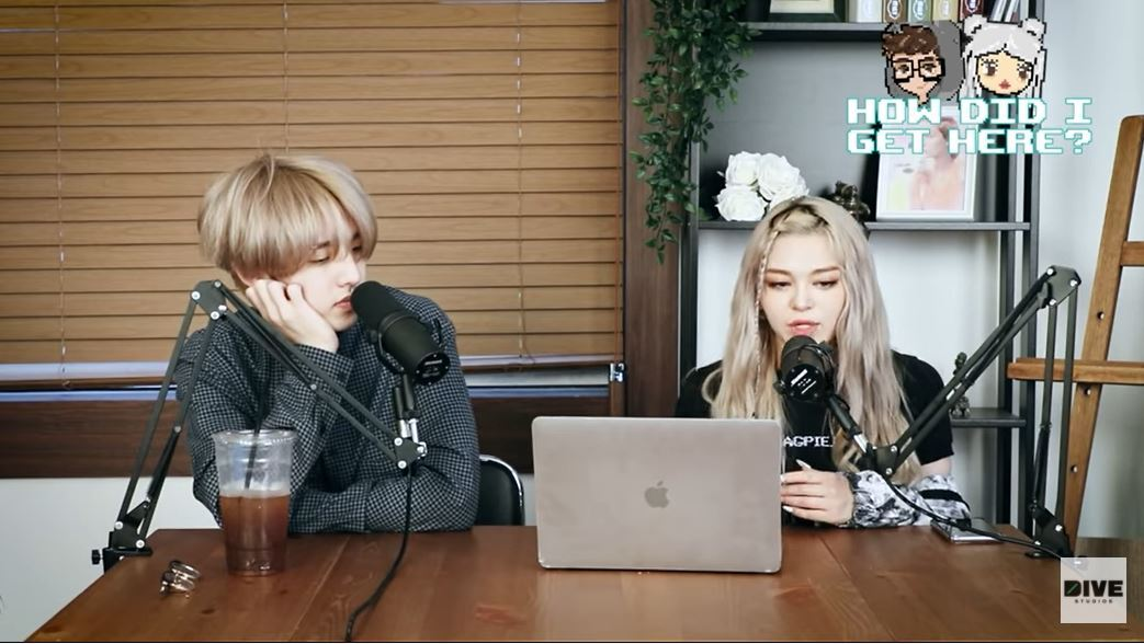 A screenshot shows the hosts of How Did I Get Here? -- Jae of JYP boy band Day6 (left) and K-pop solo artist AleXa. (YouTube)