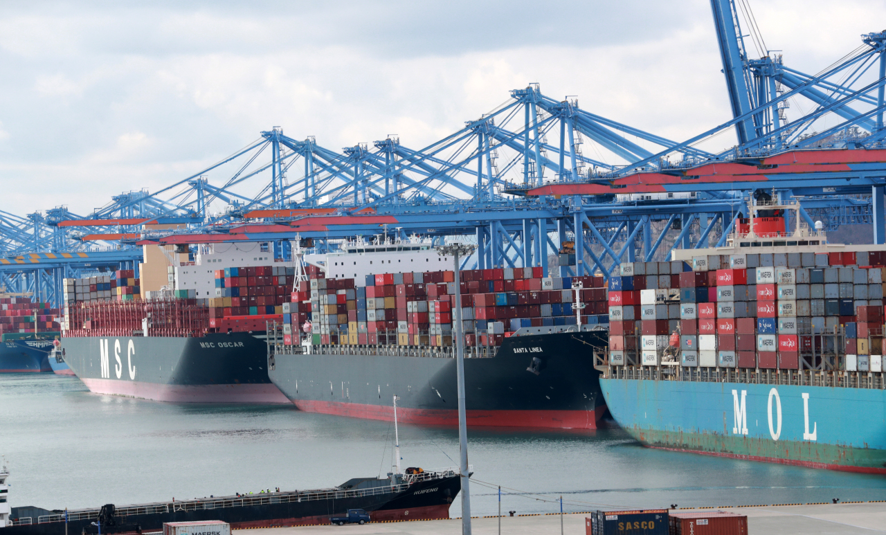 This file photo, taken on March 2, 2021, shows ships carrying containers docking at a port in South Korea's southeastern port city of Busan. (Yonhap)