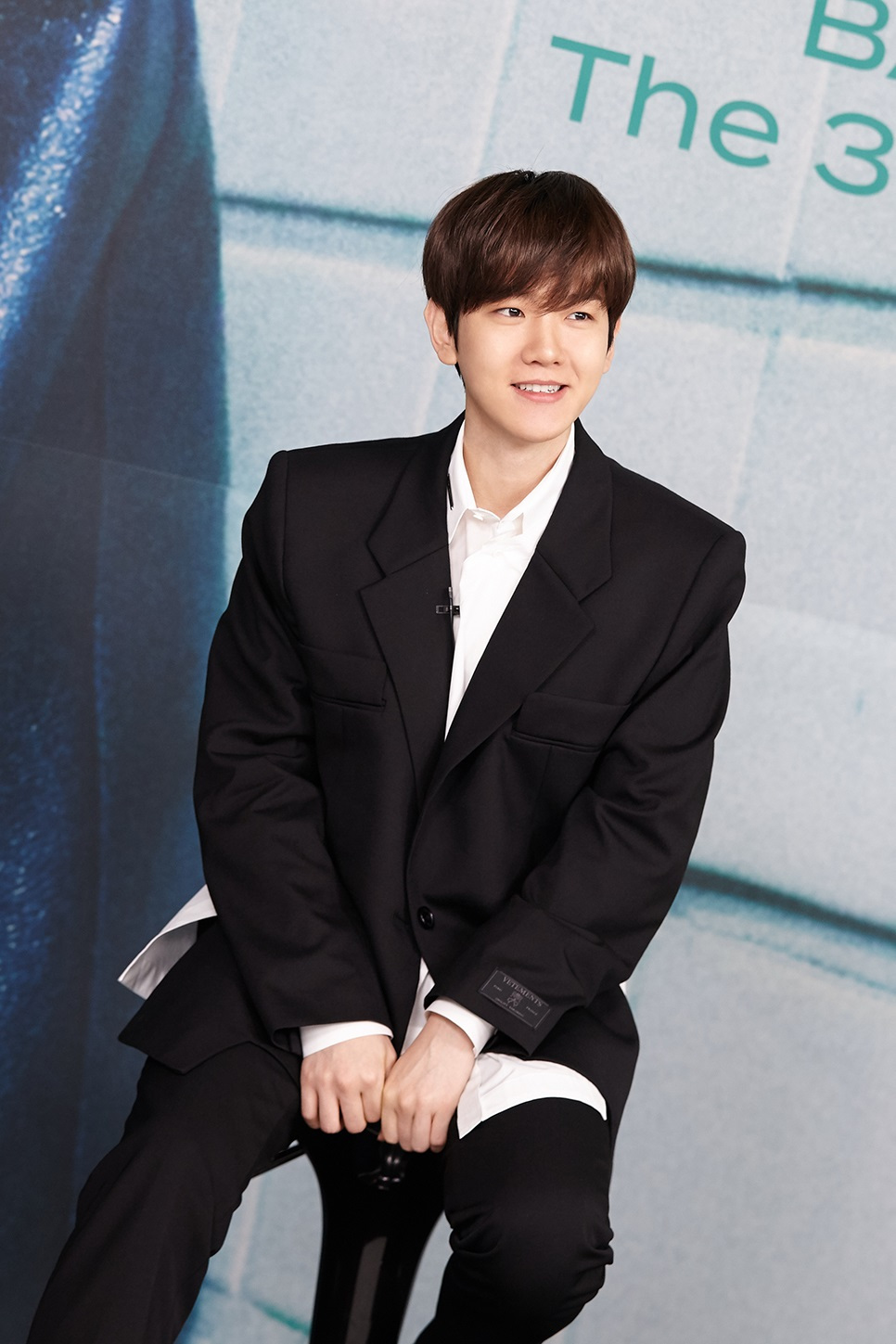 "Baekhyun speaks during a ""Bambi"" press conference Tuesday. (S.M. Entertainment)"