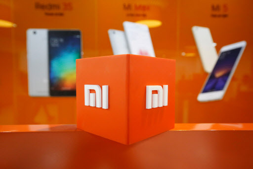 The logo of Xiaomi is seen inside the company's office in Bengaluru, India in 2018. (Reuters-Yonhap)