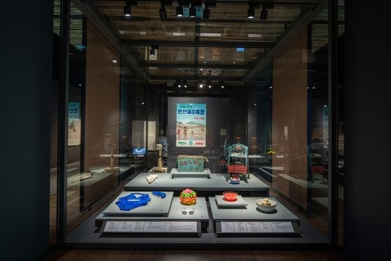 Summer items used in 20th-century Korea, such as an electric fan and swimsuit, are shown at the National Folk Museum of Korea in Permanent Exhibition Hall 2. (National Folk Museum of Korea)