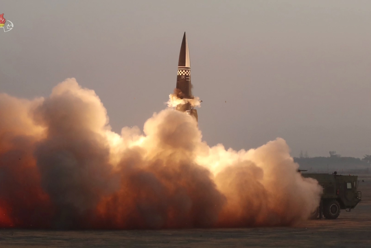 North Korea fires a ballistic missile into the East Sea, March 25, 2021. (KCNA-Yonhap)