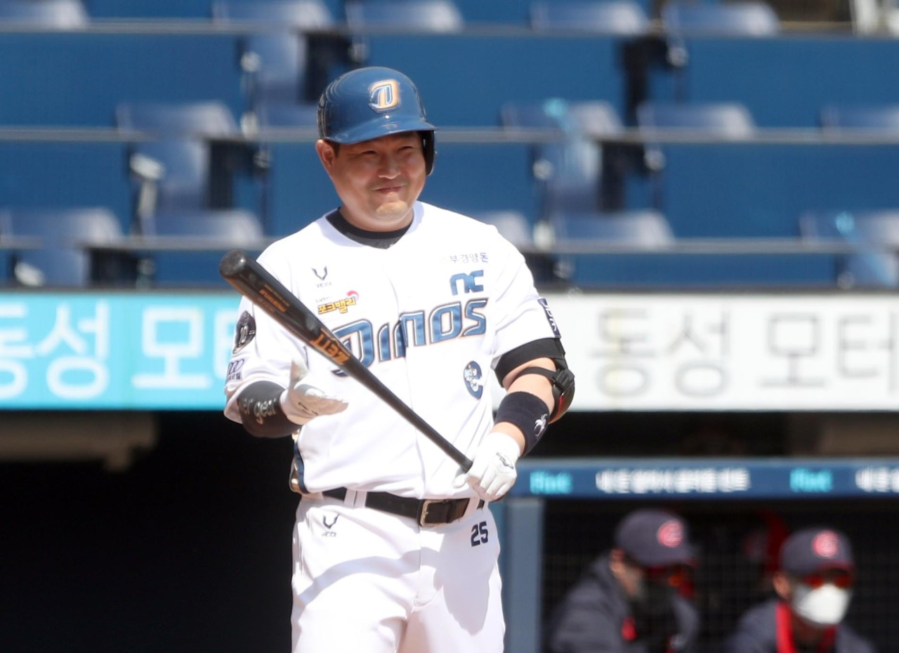 In this file photo from March 17, 2021, Yang Eui-ji of the NC Dinos smiles as he enters the batter's box in the bottom of the first inning of a Korea Baseball Organization spring training game against the Lotte Giants at Changwon NC Park in Changwon, 400 kilometers southeast of Seoul. (Yonhap)