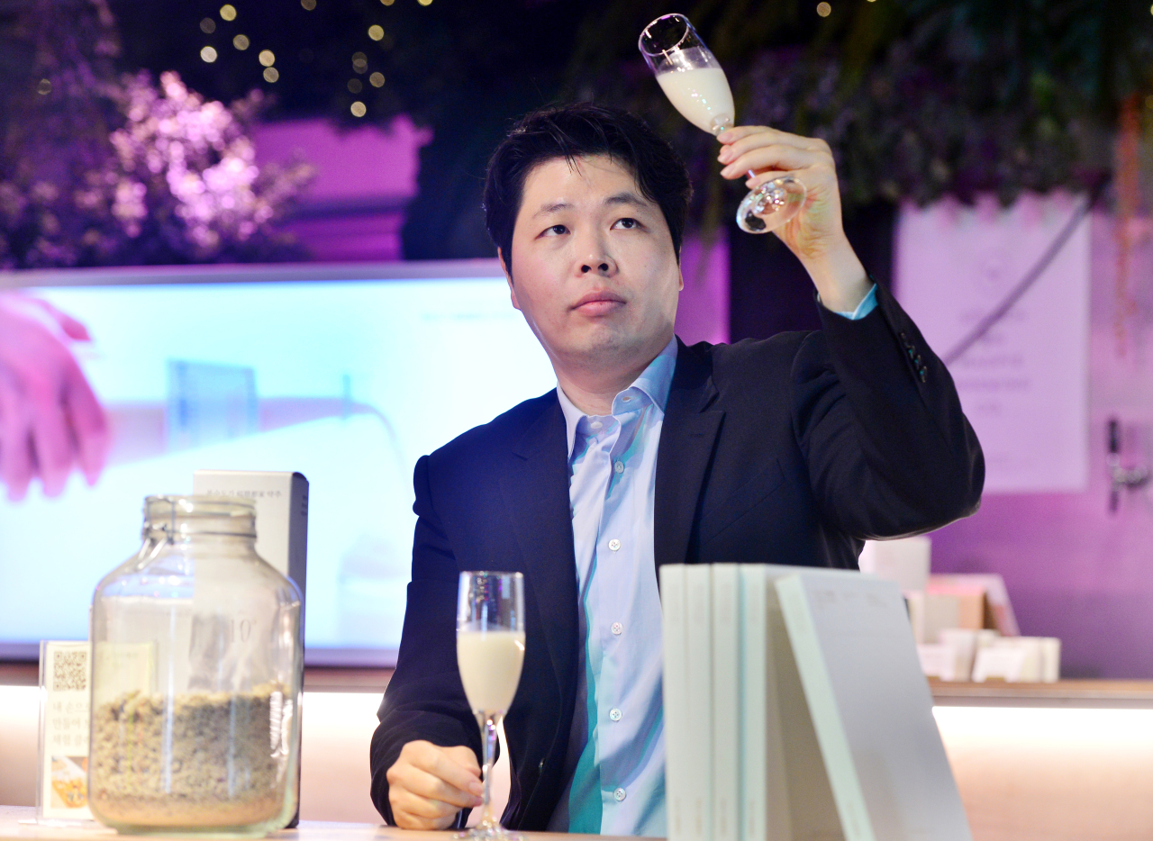 Kim Min-kyu, CEO of Boksoondoga, sits at its lounge bar Boksoondoga Nodeul Island in Seoul. (Park Hyun-koo/The Korea Herald)