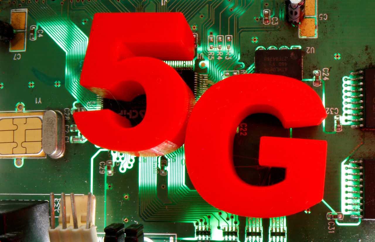 3D printed objects representing 5G are put on a motherboard in this picture illustration taken April 24, 2020. (Reuters-Yonhap)