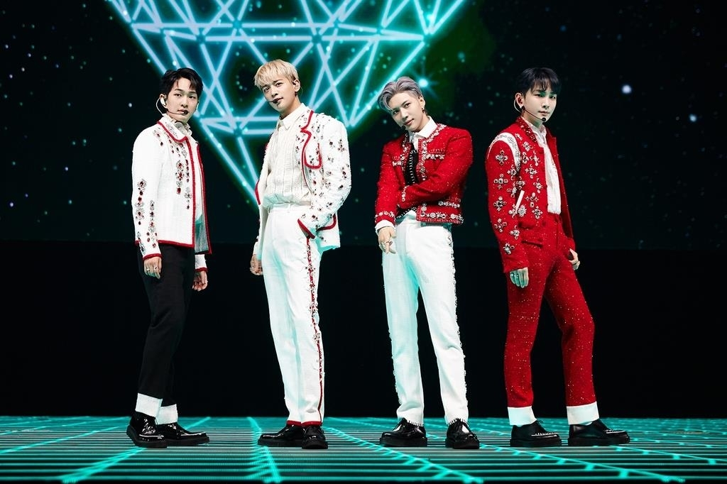This photo, provided by SM Entertainment, shows boy band SHINee performing during its online concert held on Sunday. (SM Entertainment)