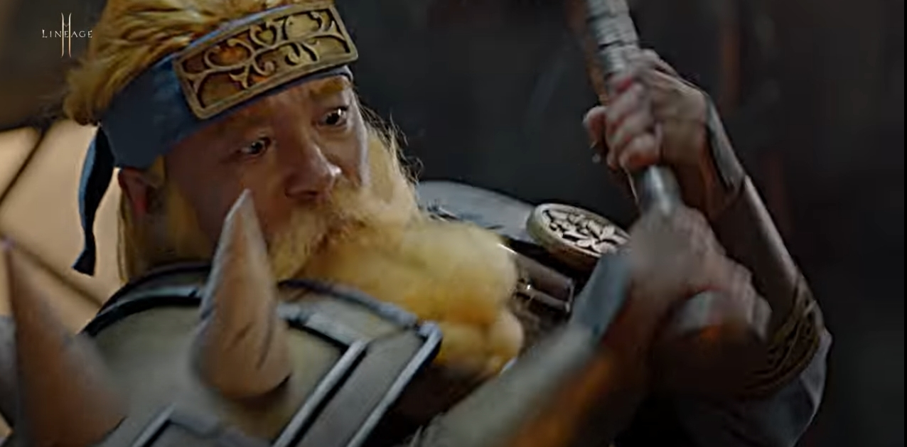 NCSoft CEO Kim Taek-jin, dressed as a dwarf, swings a hammer to strike and forge the Execution Sword in a one-minute commercial celebrating the first anniversary of Lineage 2M. (NCSoft)