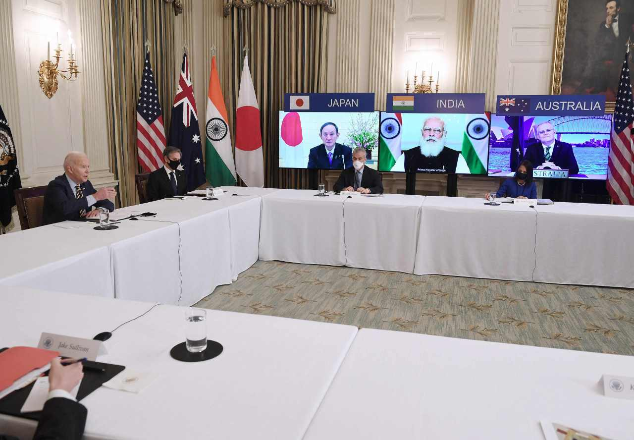 US President Joe Biden (L) holds talks via video links from Washington, D.C. with Japanese Prime Minister Yoshihide Suga, Indian Prime Minister Narendra Modi and Australian Prime Minister Scott Morrison (on screen from L to R), in a Quad summit meeting in this AFP photo on March 12, 2021. (AFP-Yonhap)