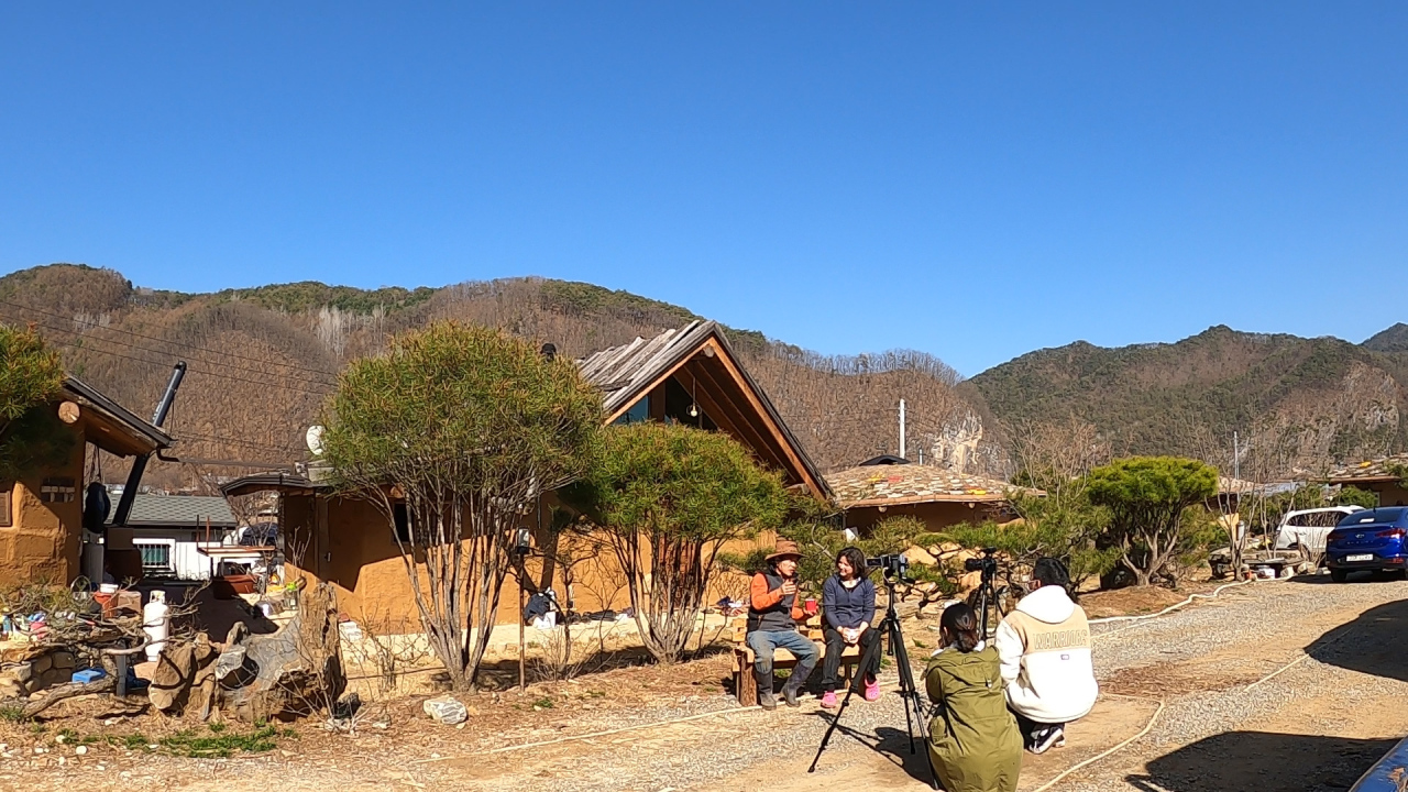 Kim and Bykova sits down infront of the ochre houses for an interview with The Korea Herald. (Kan Hyeong-woo/ The Korea Herald)