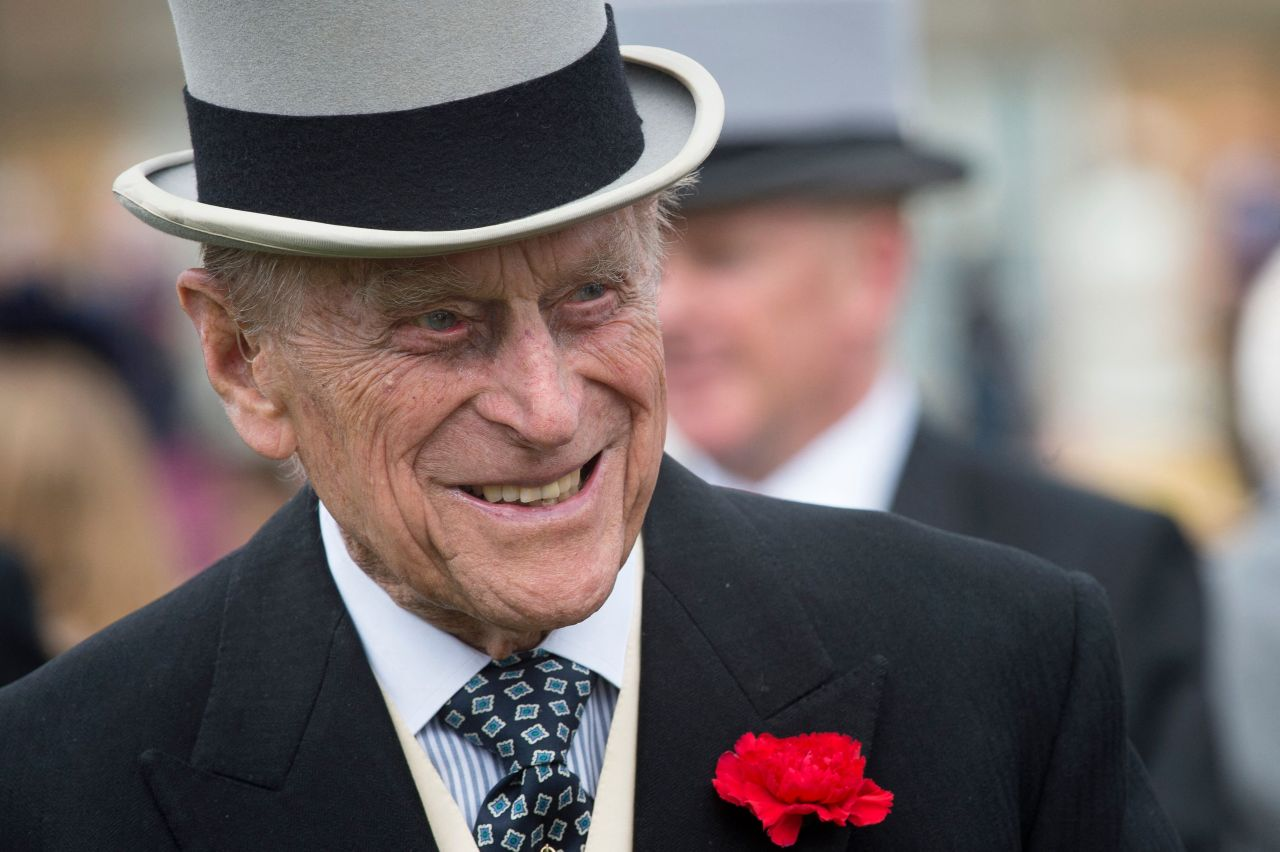 In this file photo taken on May 16, 2017 Britain's Prince Philip, Duke of Edinburgh greets guests at a garden party at Buckingham Palace in London on May 16, 2017. (AFP-Yonhap)