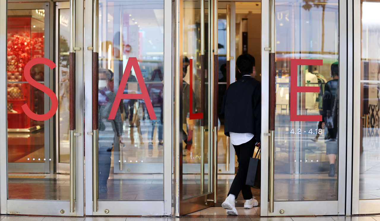 A shopper enters Lotte Department Store in central Seoul in this file photo taken on Monday.(Yonhap)
