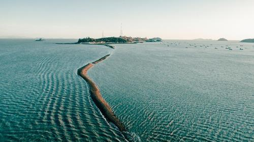 This photo provided by the southwestern South Korean county of Jindo shows a mysterious sea parting between Jindo and Modo islet. (County of Jindo)