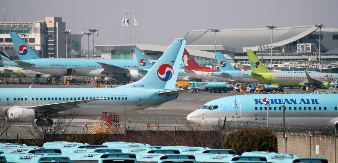 Airplanes are parked at Gimpo International Airport, western Seoul, in this file photo taken Feb. 23, 2021. (Yonhap)